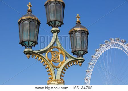 LONDON, UK - SEPTEMBER 10, 2015: London eye and lantern. Giant Ferris wheel opened on 31 December 1999, the most famous attraction in centre London