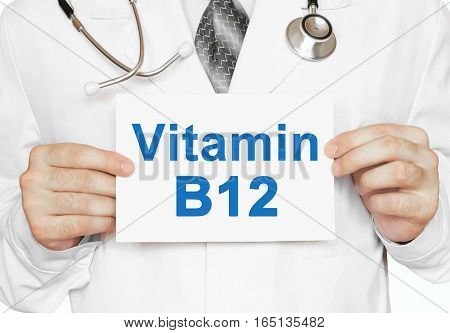 Doctor Holding A Card With Vitamin B12, Medical Concept
