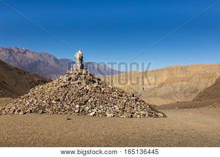 traditional tibetan pile of stones on the pass Himalayas Nepal