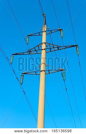 Tower of power transmission line on background of blue sky