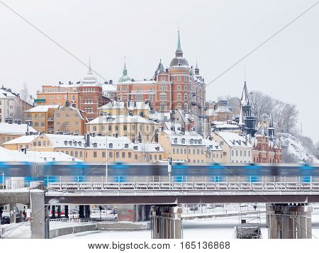 STOCKHOLM - JAN 08 2017: Subway and fantastic architecture with brick wall in central stockholm a sunny winter day ice on the sea. January 08 2017 in Stockholm Sweden