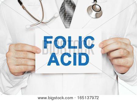 Folic Acid Card In Hands Of Medical Doctor