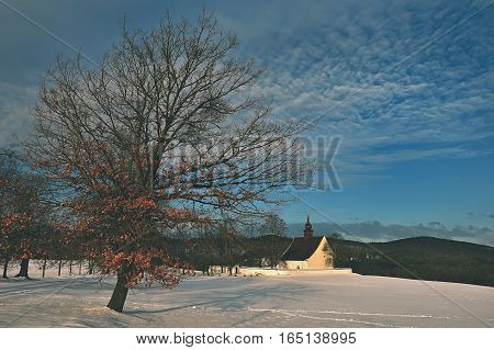 Winter landscape with a beautiful chapel near castle Veveri. Czech Republic city of Brno. The Chapel of the Mother of God.