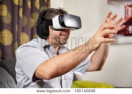 Man With Vr Virtual Reality Headset Grabbing With Hands