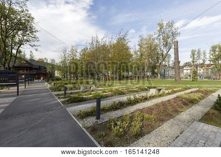 ZAKOPANE POLAND - SEPTEMBER 23 2016: Alleys runs through the city park named Marshal Jozef Pilsudski the revitalization of the park was completed in 2013