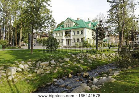 ZAKOPANE POLAND - SEPTEMBER 23 2016: Former Municipal Baths building at the side of city park. This building was built in 1928 and is registered as a municipal architectural heritage