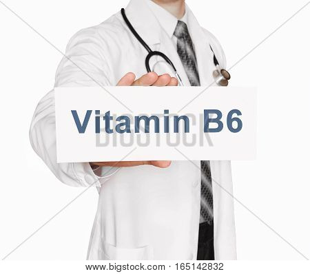 Doctor holding a card with Vitamin B6 Medical concept