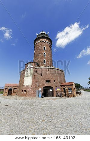 KOLOBRZEG POLAND - JUNE 22 2016: Massive lighthouse is made of brick. This is one of the most visited and the most recognizable tourist attractions in the city.