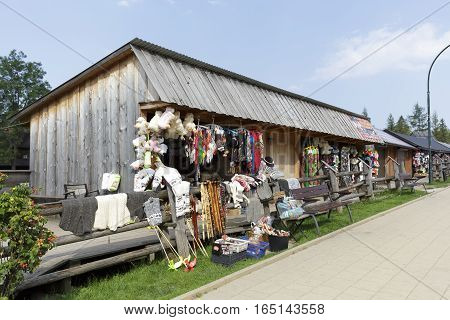 ZAKOPANE POLAND - SEPTEMBER 12 2016: Commercial pavilions in which variety of souvenirs are put on sale. These stands are made of wood as provisional.