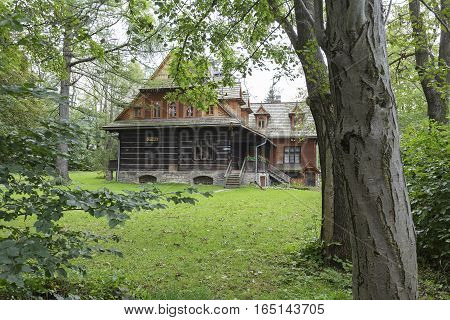 ZAKOPANE POLAND - SEPTEMBER 20 2016: Wooden villa named Ornak in Zakopane can be seen from front side. This villa was built in the early twentieth century and is a monument of wooden architecture