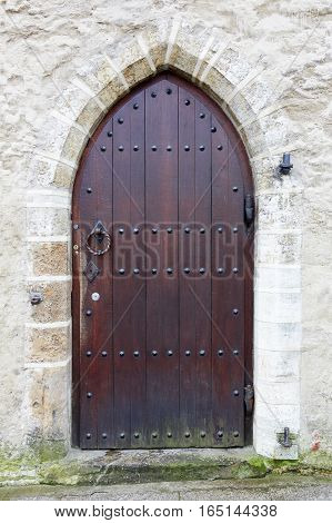 old door arch in the stone wall of the Church