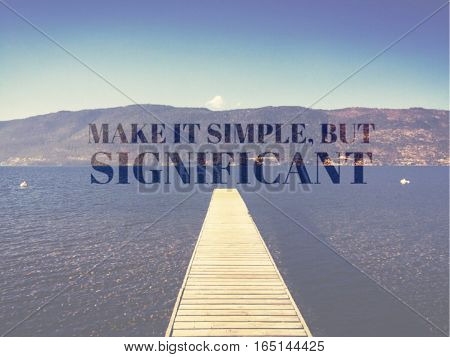 Inspirational quote on lake landscape with wooden pier in water on a bright sunny day.  Mountains and bright clear blue sky in background.  Lighting effects applied.