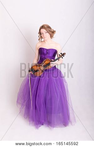 woman in a purple dress with a violin