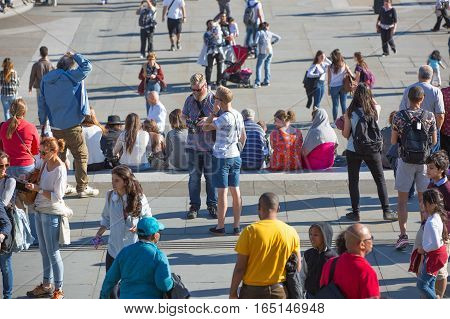 LONDON, UK - SEPTEMBER 10, 2015: Lots of people at the Trafalgar square in the hot sunny day