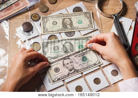 Woman Holds A Set Of Dollars In The Pockets