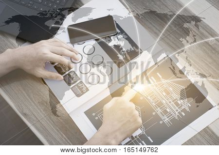 business globalization technology connection conceptBusiness people hands use smart phone and laptop for business analyst project on tableselective focus.