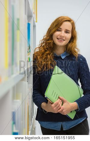 Clever University Student Studying In White Modern Library Books