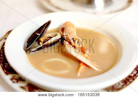 Fish soup with shrimp and mussels. Spanish food