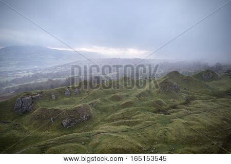 Stunning Landscape Image Of Abandoned Quarry Taken Over By Nature In Autumn Fall At Sunrise With Fog
