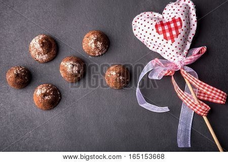 Truffles On A Black Background, And Rag Greeting Hearts, Top View