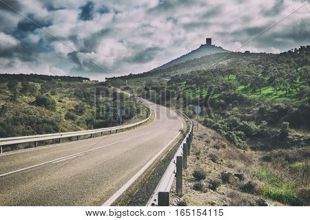 Lonely country road to Feria Castle Hill Extremadura Spain