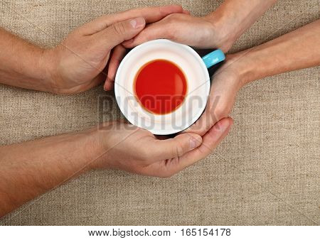 Man And Woman Hands Hold Empty Black Tea Cup