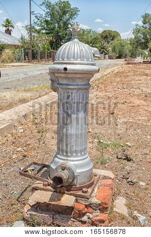 An historic coin-operated water pump in Jagersfontein a diamond mining town in the Free State Province of South Africa