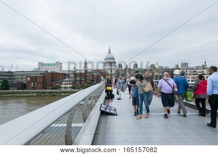 London, England - 28 July 2016 : Tourists Walking Across The Millennium Bridge, Which Is A Steel Sus