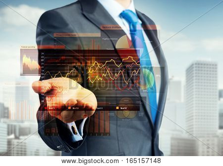 Close up of businessman palm presenting virtual graphs and charts