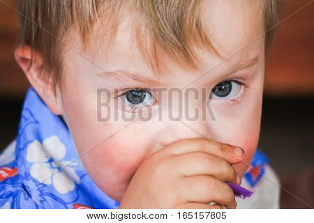 Close up of Cute Boy With Downs-Syndrome