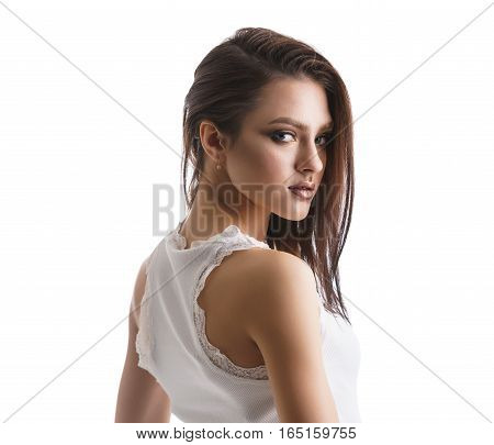 Sexy brunette in beautiful white lace top studio portrait