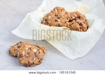 Flourless gluten free peanut butter oatmeal and chocolate chips cookies on cooling rack horizontal