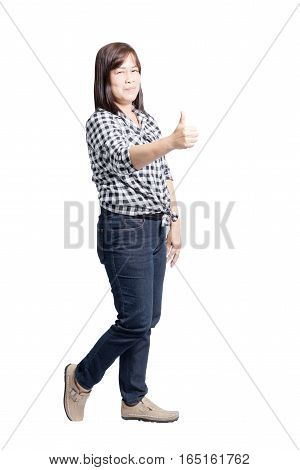Portrait Of A Mature Woman Smiling And Showing Thumb Up. Isolated On White Background