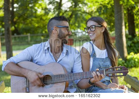 Young Couple In Love Takes A Selfie While Plays Guitar