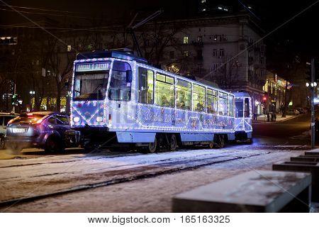 Dnepr, Ukraine - JANUARY 1, 2017:  Christmas tram with festive lights in Budapest on Dnepr on JANUARY 1, 2017
