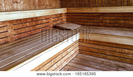 relax and get away conceptual health and wellness photo of classic wood sauna room interior
