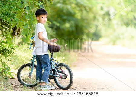 Young Boy Stand With His Bicycle