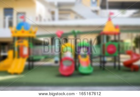 Blurred colorful playground on yard in school stock photo