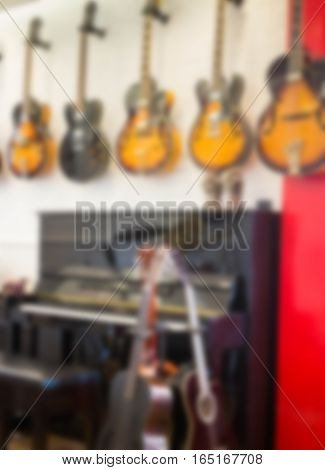 Blurred quitar and piano in the music room stock photo