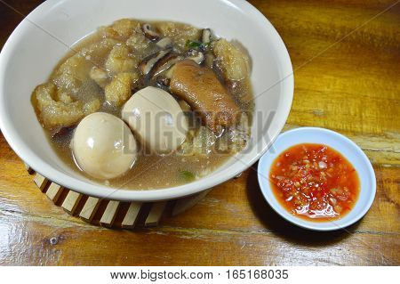 braised fish maw in red gravy topping boiled egg and spicy chili sauce