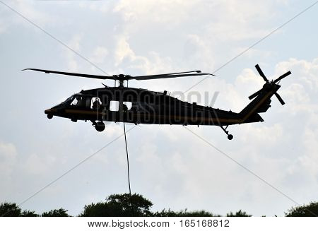 Modern military helicopter in airlift rescue mission