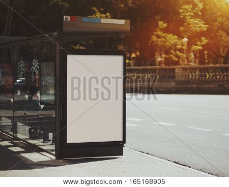 City bus stop with empty mock up banner for your advertising blank billboard with copy space area for your text message or promotional content public information board in urban setting