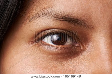 Macro of woman dark brown eye without cosmetic or makeup