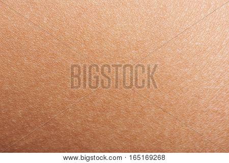 Dark skin of woman hand macro. Human skin texture background