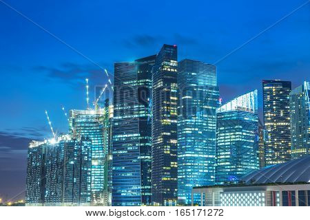 abstract cityscape building on nearly evening filter blue - can use to display or montage