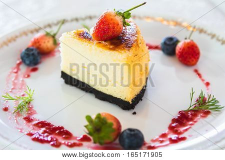 cheesecake with fresh strawberry and blueberry decoration
