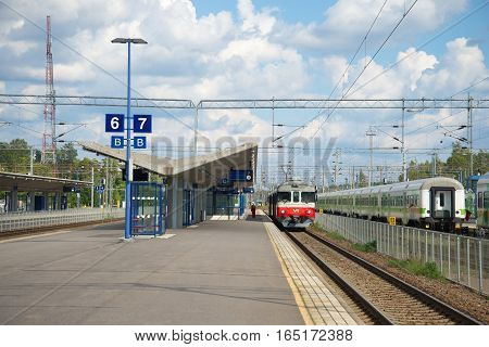 KOUVOLA, FINLAND - AUG 20, 2016: On the platform of the railway station of Kouvola cloud on a summer day