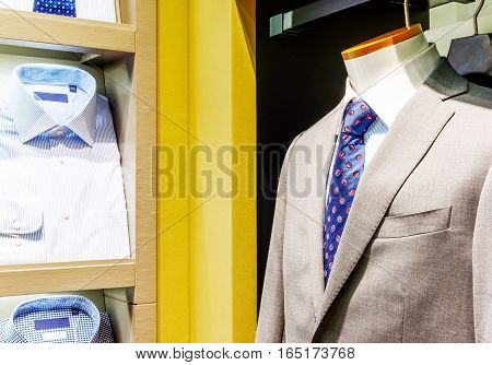 Shopping malls clothing display wearing a suit of the model.