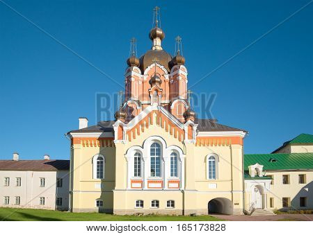 Church of Erection of the Lord's Honest Cross in the Tikhvin Uspensky monastery close up in the sunny day. Tikhvin, Russia