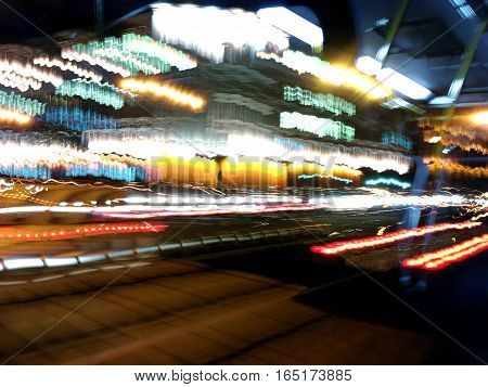 Night Motion On Urban Street. Blurred Car Lights. Long Exposure.